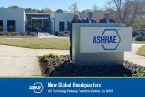 Ginger Scoggins, Chuck Gulledge and Jeff Littleton in front of the new ASHRAE headquarters.
